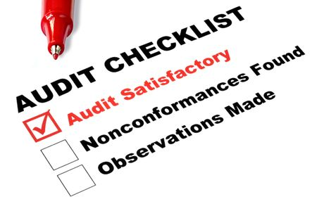 satisfactory: Audit checklist, with tick against audit satisfactory,   Stock Photo
