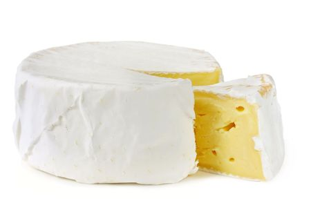 A wheel of rich creamy brie cheese, with a wedge cut out.  Isolated on white. Stock Photo - 3466221