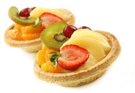glazed: Small custard and glazed fruit tarts, isolated on white. Stock Photo