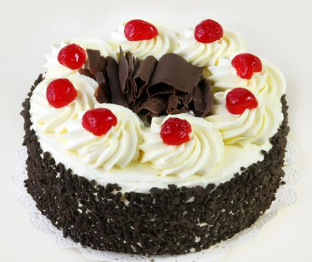 whipped: Black forest cake, topped with whipped cream and cherries.
