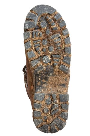 Muddy sole of a hiking boot, isolated on white. photo