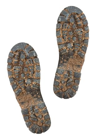 Muddy soles of hiking boots, isolated on white. photo