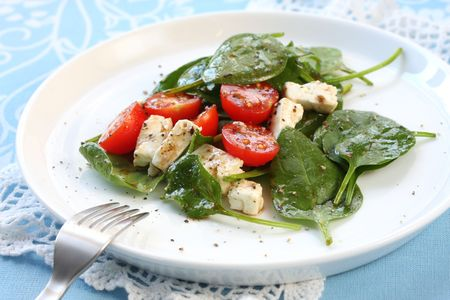 'baby spinach': Salad of baby spinach leaves, with cherry tomatoes, goat cheese, and a balsamic dressing.