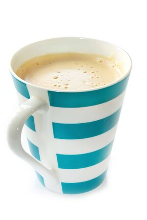 coffeebreak: Blue and white striped mug of frothy coffee.  Isolated on white.
