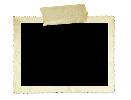 Vintage photo frame, with scalloped edge and masking tape, isolated on white. Stock Photo