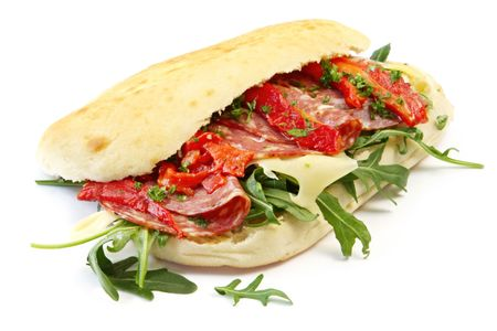 Foccacia with salami, Swiss cheese, grilled red capsicum strips, and rocket leaves.  Delicious! Stock Photo - 3636455