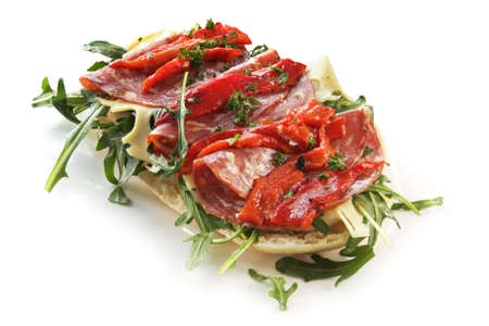 Focaccia bread with rocket leaves, salami, Swiss cheese and grilled bell peppers. Stock Photo - 3636462