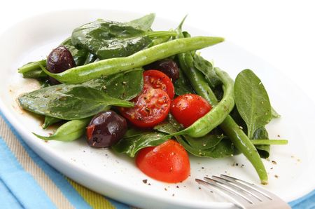 balsamic: Sald of spinach leaves, chery tomatoes, green beans and black olives, with a balsamic dressing.
