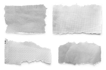 Newspaper tears collection, casting natural shadow on white.