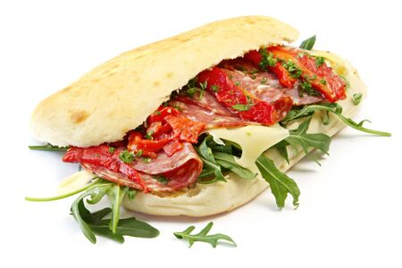 Foccacia with salami, Swiss cheese, grilled red capsicum strips, and rocket leaves.  Delicious! Stock Photo - 3639465