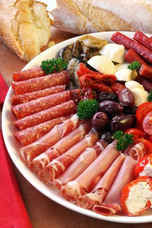 crusty: Platter of antipasti appetizers, with crusty bread.