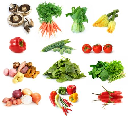 desiree: Collection of vegetables, isolated on white.  Includes mushrooms, carrots, bok choy, zucchini, bell peppers, peas potatoes, onions, spinach, chili pepper, broccoli, asparagus, lettuce, and tomatoes. Stock Photo
