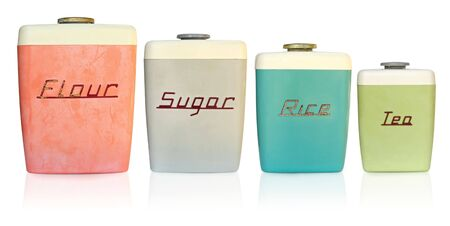Retro 1950s kitchen storage canisters for flour, sugar, rice and tea.   Stock Photo