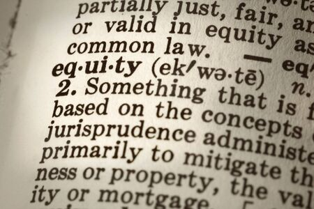 dictionary definition: Dictionary definition of the word equity.  Close-up view, with sepia tone and differential focus.