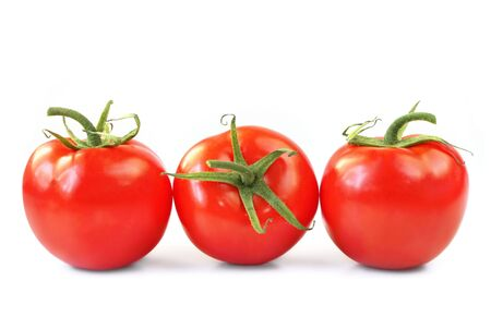 truss: Three vine ripened truss tomatoes, isolated on white.  Natural light.