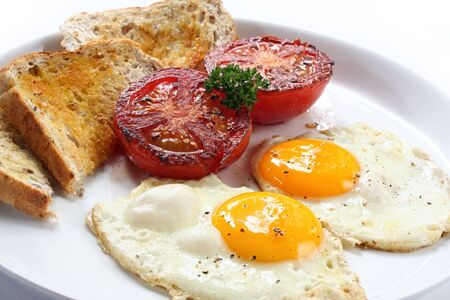 sunnyside: Breakfast of fried eggs and tomatoes, with wholewheat toast.