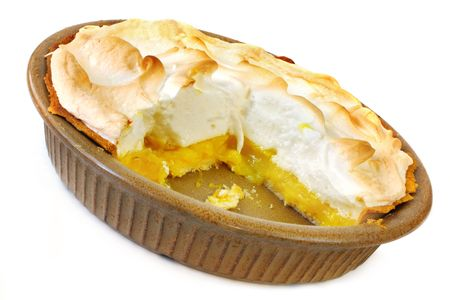 Meringue: Home-baked lemon meringue pie, with a slice cut out.  Old-fashioned pottery pie plate, isolated on white.
