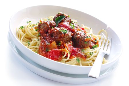 White bowl of spaghetti and meatballs in a bolognese sauce.  Isolated on white. Stock Photo - 3737623