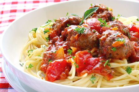 Bowl of spaghetti and meatballs, in a tomato sauce. Stock Photo
