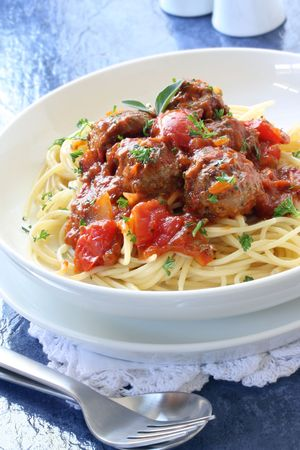Spaghetti and meatballs, in a tomato sauce.  Delicious homely food. Stock Photo - 3737629