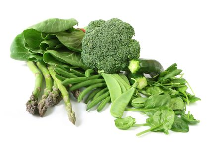 snap bean: Green vegetables on white background.  Includes asparagus, zucchini or courgette,  broccoli, bok choy, beans, spinach, and snow peas.