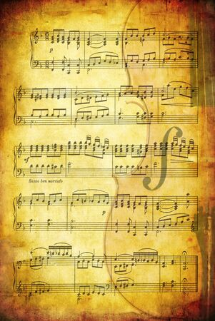 paper textures: Grunge background with sheet music and a cello.  Great textures of paper and stone.