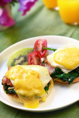 indulgent: Eggs benedict.  Poached eggs on toasted muffins, with spinach, ham and hollandaise sauce.  Accompanied by fresh fruit and juice.  An indulgent breakfast!