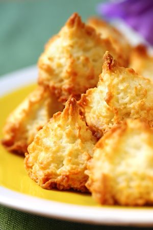 Coconut macaroons on a sunny yellow plate.  Soft focus, shallow depth of field. photo
