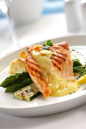 Atlantic salmon, with bearnaise sauce, over roasted potatoes, asparagus and grilled courgette.  Delicious healthy eating. photo