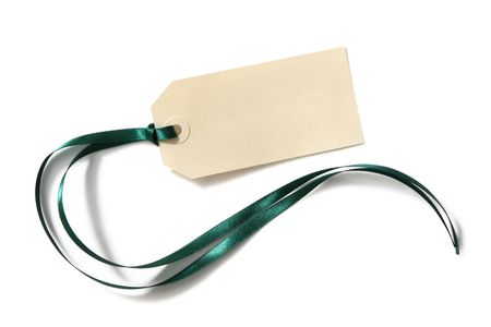 gift tag: Blank tag tied with green satin ribbon.  Casting natural shadow on white. Stock Photo