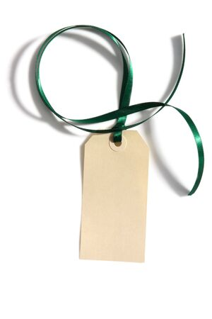 gift tag: Blank tag tied with green satin ribbon.  Casting shadow on white background.