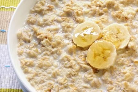 porridge: Porridge with banana and honey.  Traditional Scottish oatmeal. Stock Photo