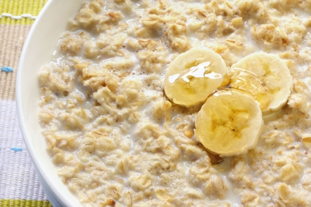 Porridge with banana and honey.  Traditional Scottish oatmeal. Stock Photo