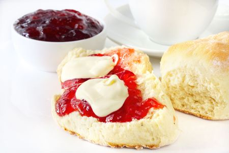 scones: Fresh scones with strawberry jam and fresh cream, served with a cup of tea.  Known as a Devonshire tea or cream tea.
