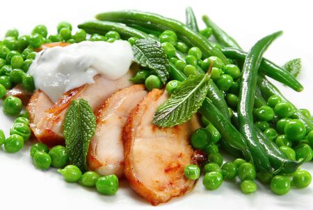 Smoked chicken with fresh minted peas and beans, with tzatziki dressing. Stock Photo