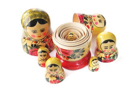 A family of Russian Babushka nesting dolls, isolated on white. Stock Photo
