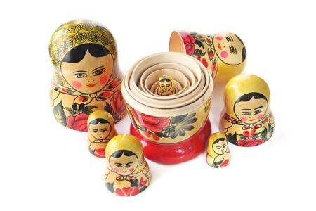 russian nesting dolls: A family of Russian Babushka nesting dolls, isolated on white. Stock Photo