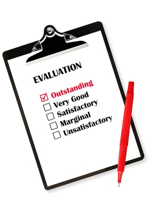 outstanding: Outstanding evaluation on clipboard, with red pen. Stock Photo