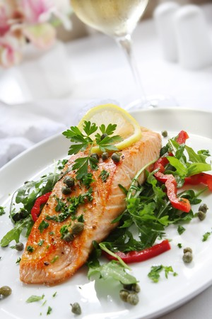 salmon steak: Grilled Atlantic salmon with a rocket salad, capers, parsley and lemon.