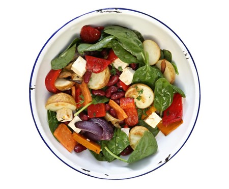 Salad with roasted vegetables, kidney beans, and baby spinach leaves, in old enamel bowl. path included. photo