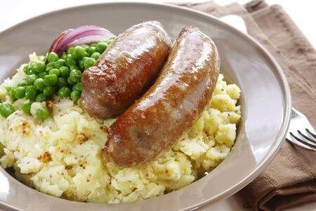 Bangers and mash ~ sausages over mashed potato with seeded mustard, and peas.