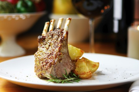 Rack of lamb with seeded mustard, rosemary and roasted potatoes.   photo