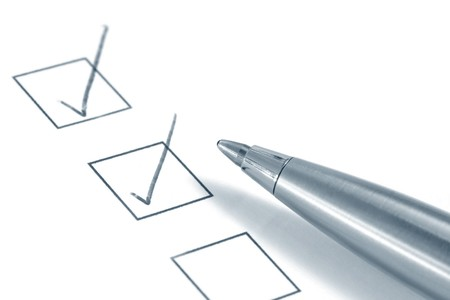 toned image: Ballpoint pen over checkboxes, with plenty of copy-space.  Toned image. Stock Photo