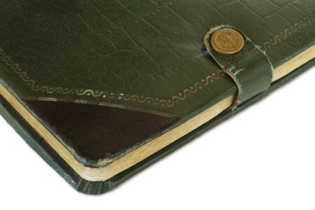 Old green and gold leather-bound book, with stud closer.  This is a 70 year old autograph book. photo