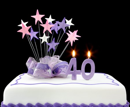 Fancy cake with number 40 candles.  Decorated with ribbons and star-shapes, in pastel tones on black background. Stock Photo - 4315727