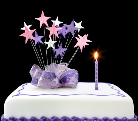 Fancy cake with a single lit candle.  Pastel tones, with ribbons and stars.