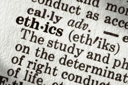 Dictionary definition of the word ethics, in macro. photo