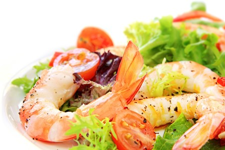 Prawn salad.  Simple and healthy salad of shrimp, mixed greens and tomatoes. photo