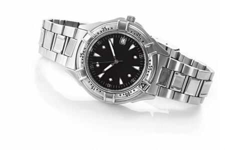 mens: Chrome and black wrist watch, casting reflection on white. Stock Photo