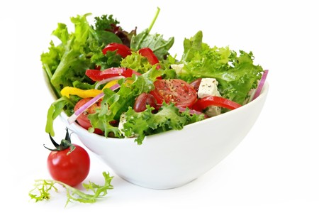 spinach salad: Healthy garden salad in stylish white bowl, isolated on white.